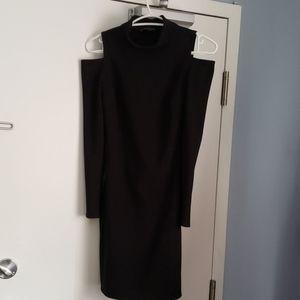 Exposed shoulder black dress